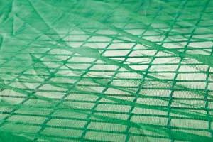 Overlay panel in green, air permeable